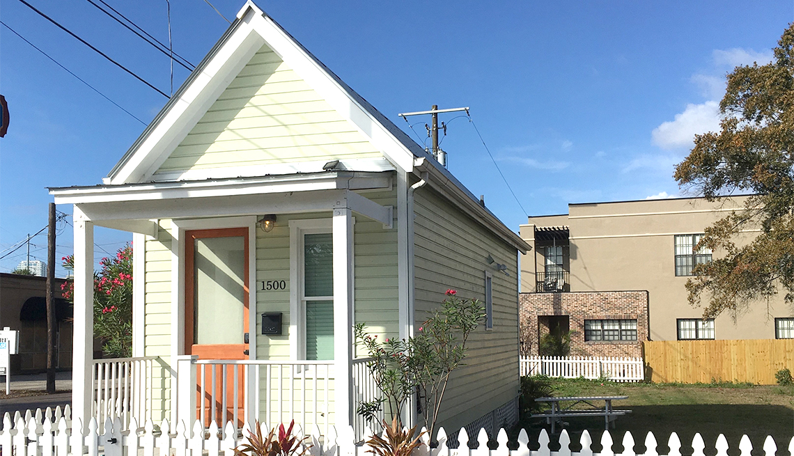 A tiny home with a small fenced yard