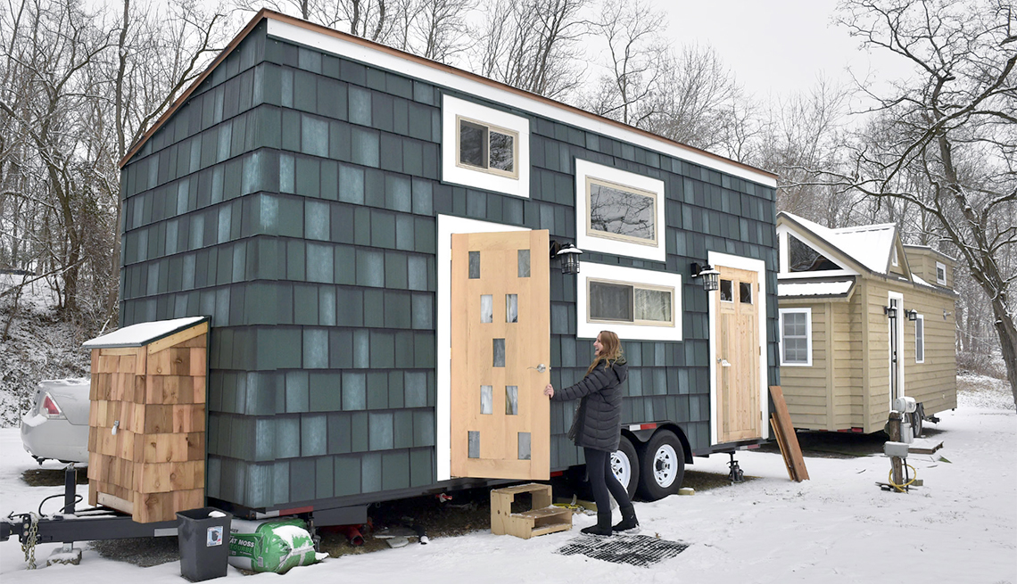 A tiny home is on wheels to be transported to a new location