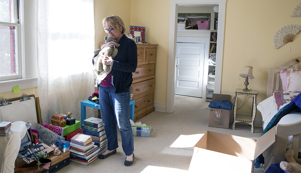 Middle aged woman packing up