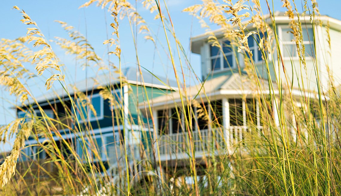 Beach-front homes seen through beach grass in Gulfport, Florida.