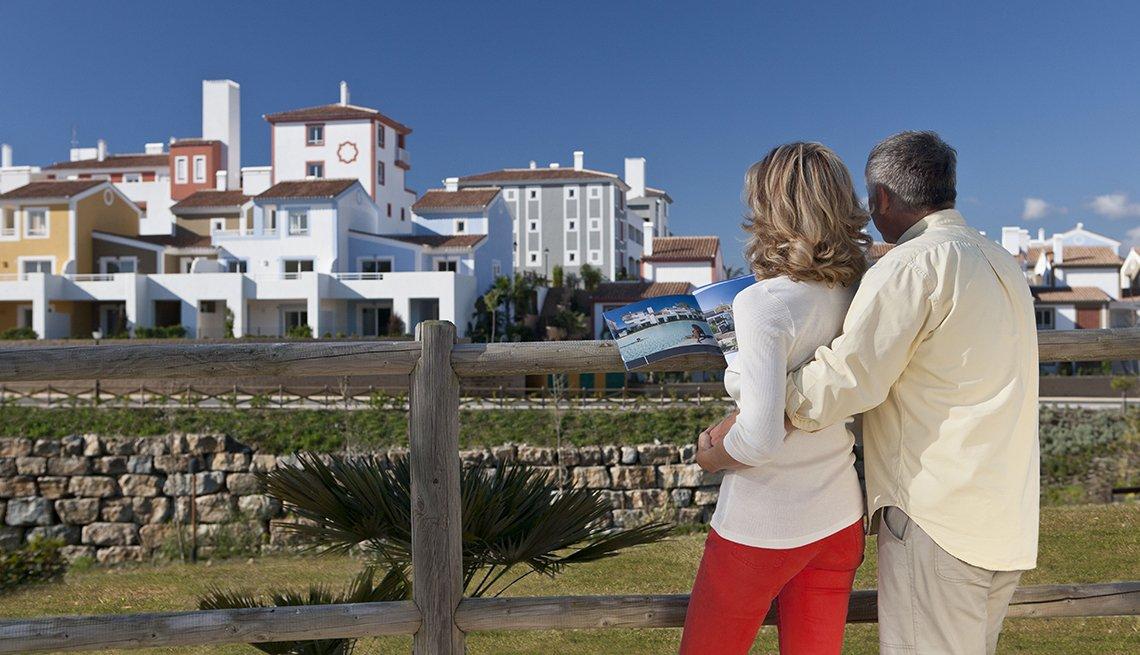 mature couple looking at retirement development