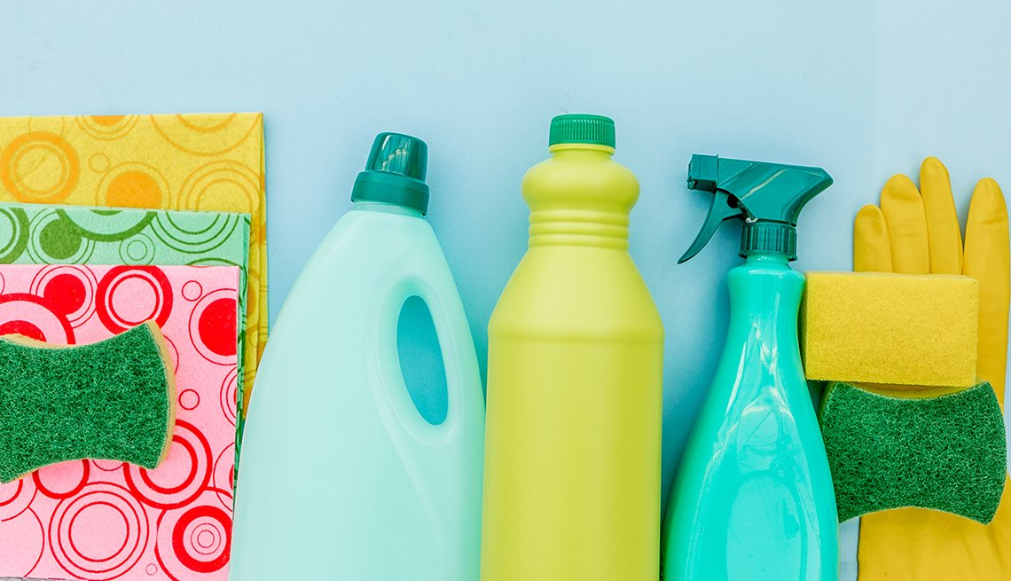 cleaning products and sponges and gloves on a blue background