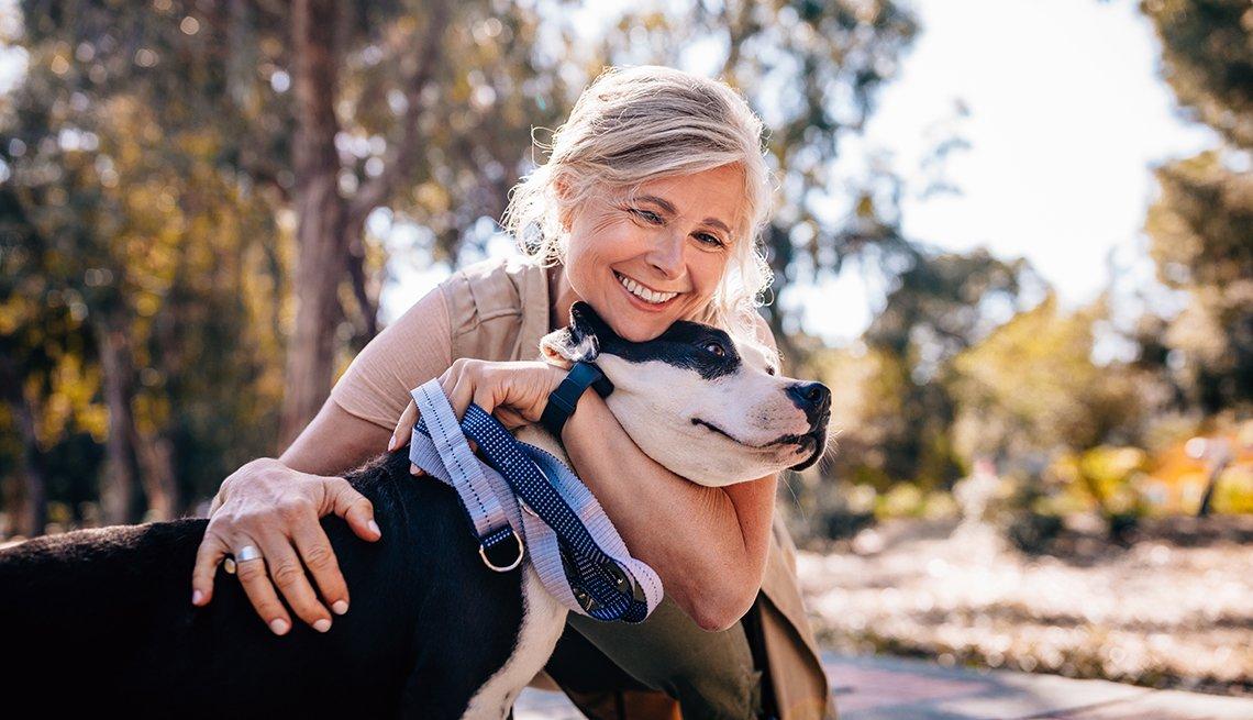 a woman hugs a dog