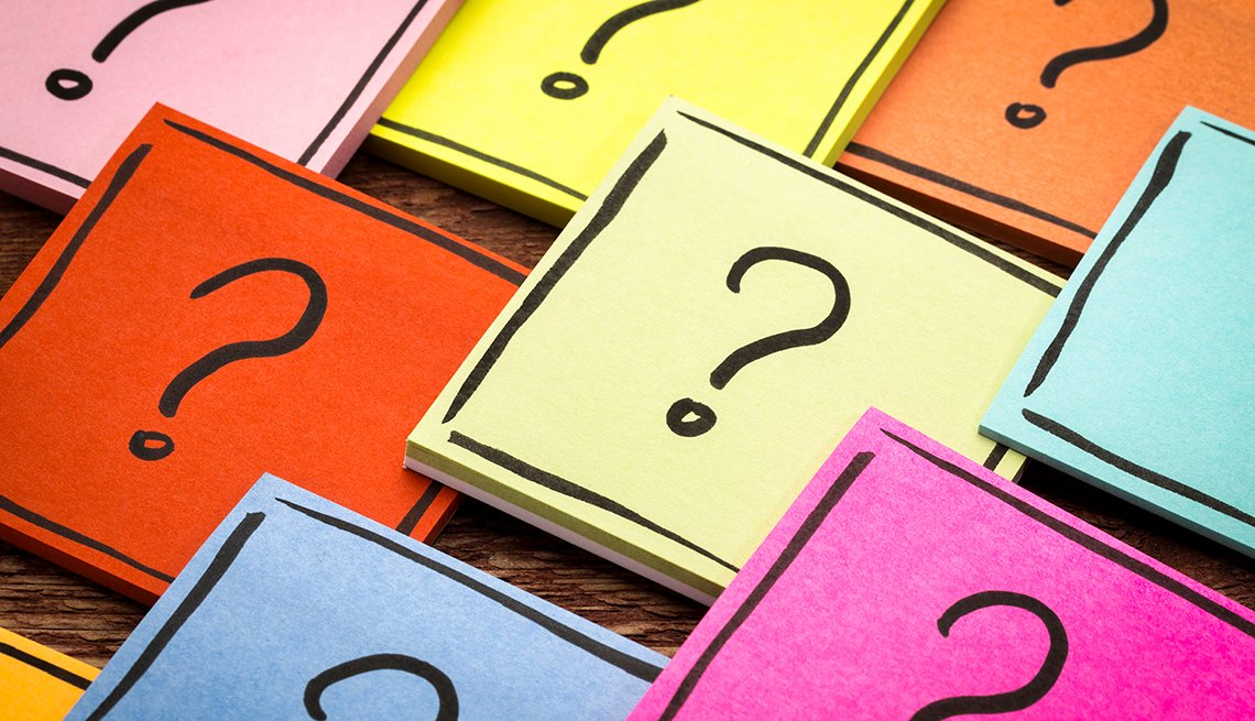 question marks on sheets of different colored paper