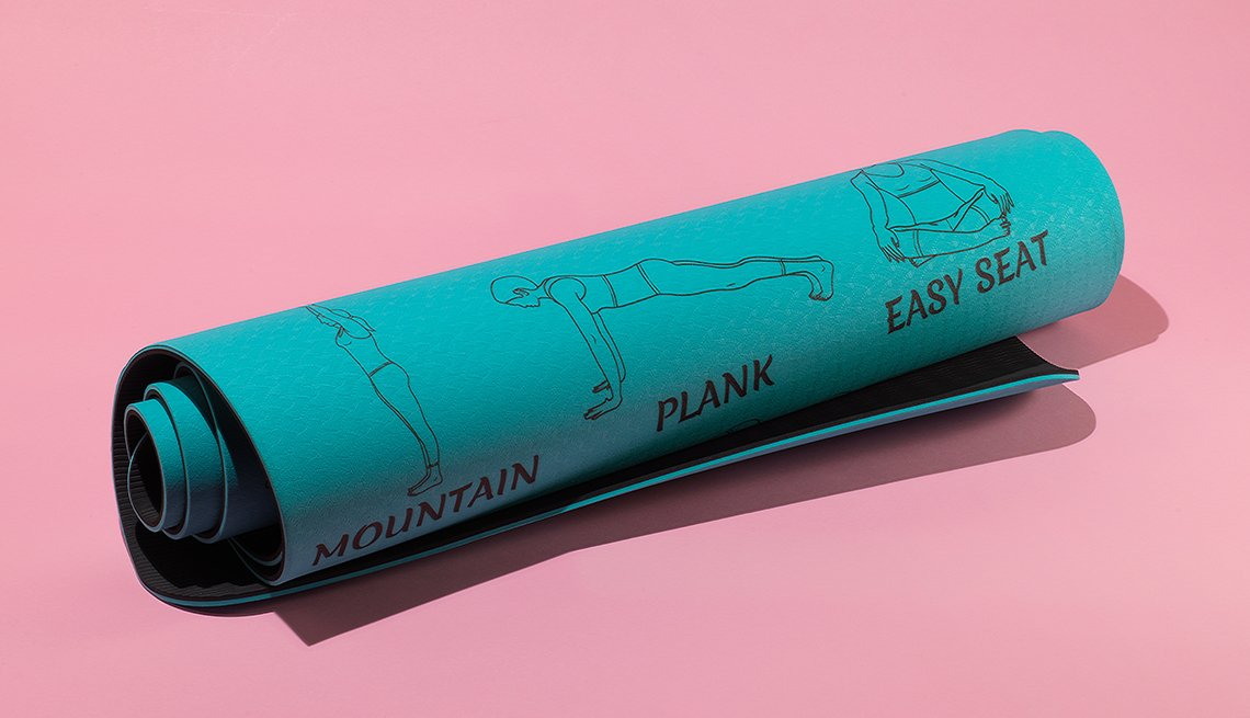 item 8 of Gallery image - a rolled up yoga mat that has diagrams of several yoga poses along with their names