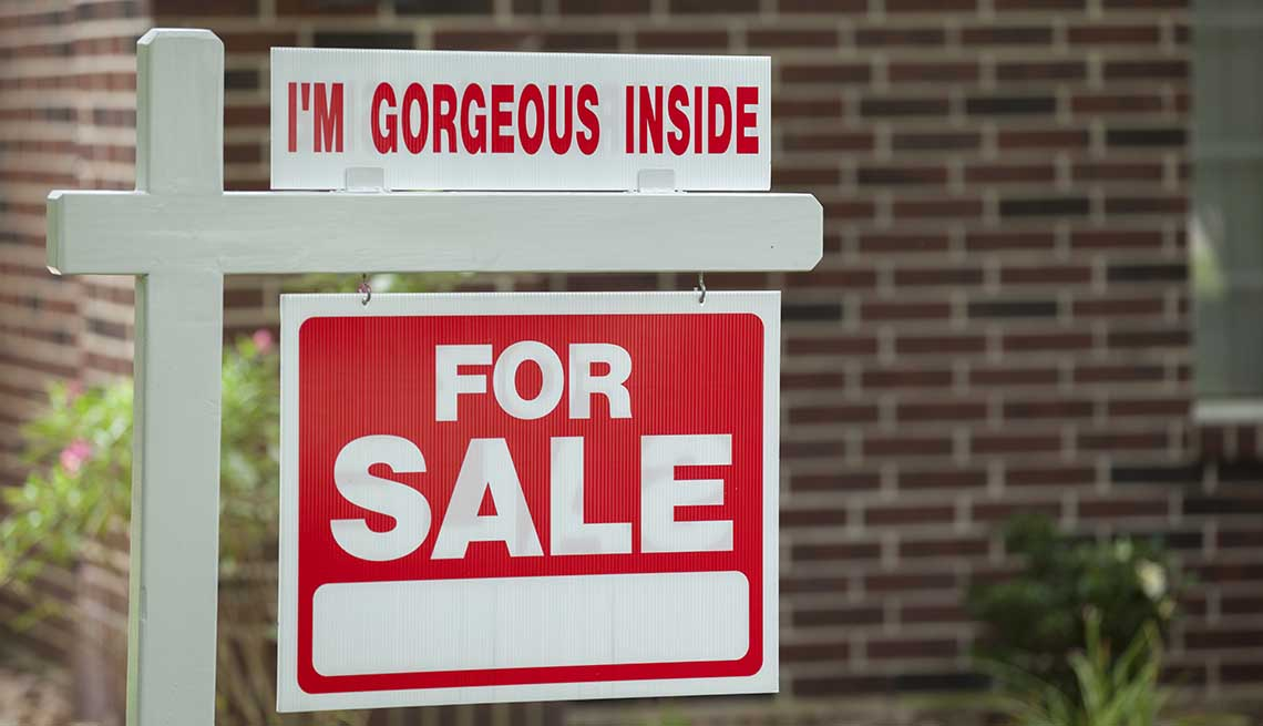 Real estate sign in residential neighborhood.  Moving house, relocation concepts.
