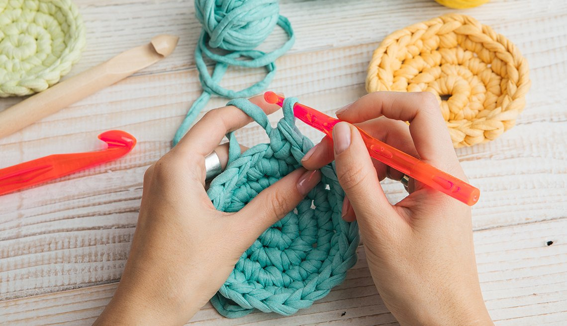 Hand made hobby crafts things. woman hands knitting crochet.
