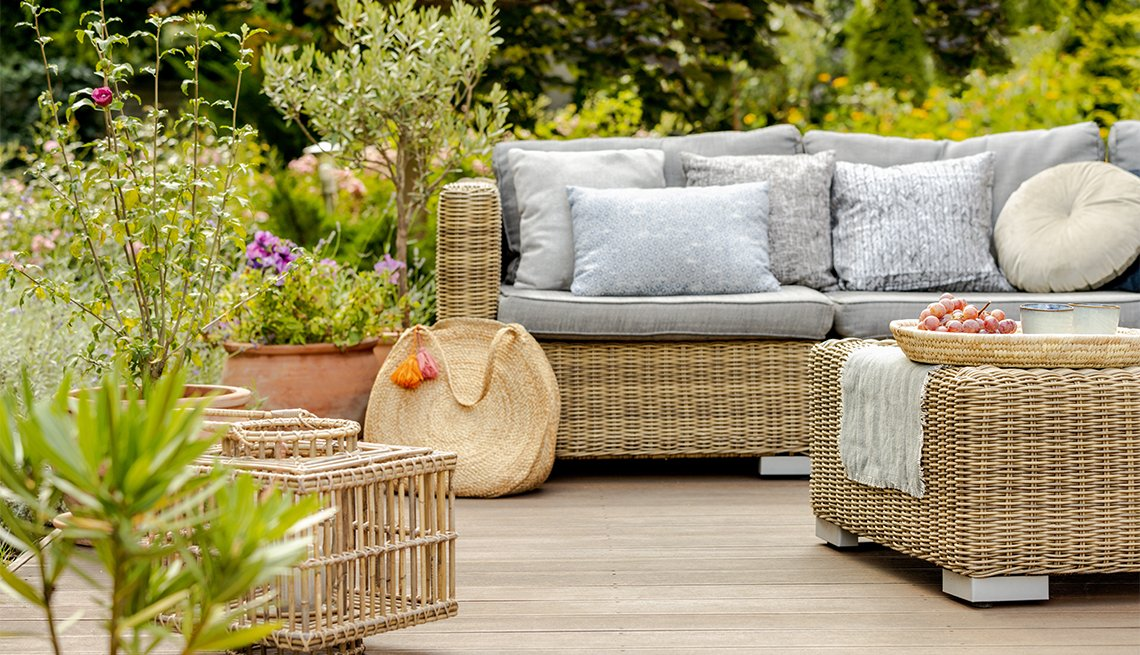 Modern designed terrace with wicker furniture and plants