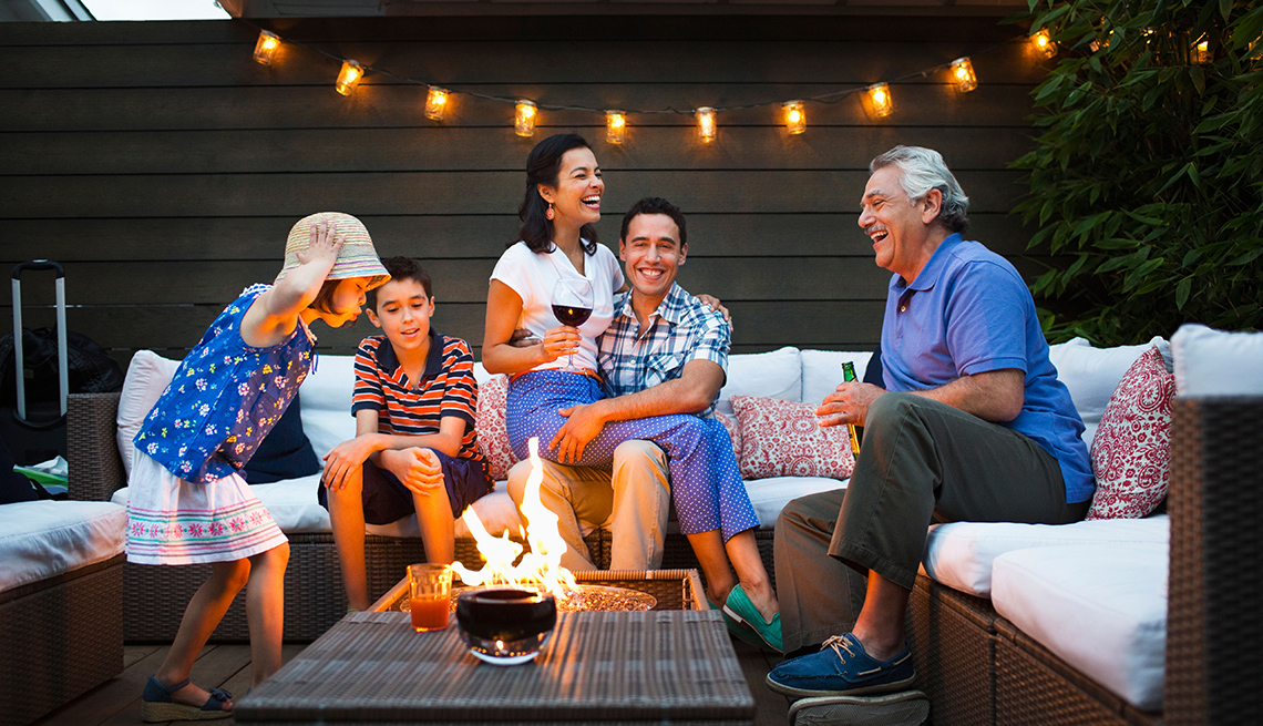 Family relaxing around fire pit outdoors