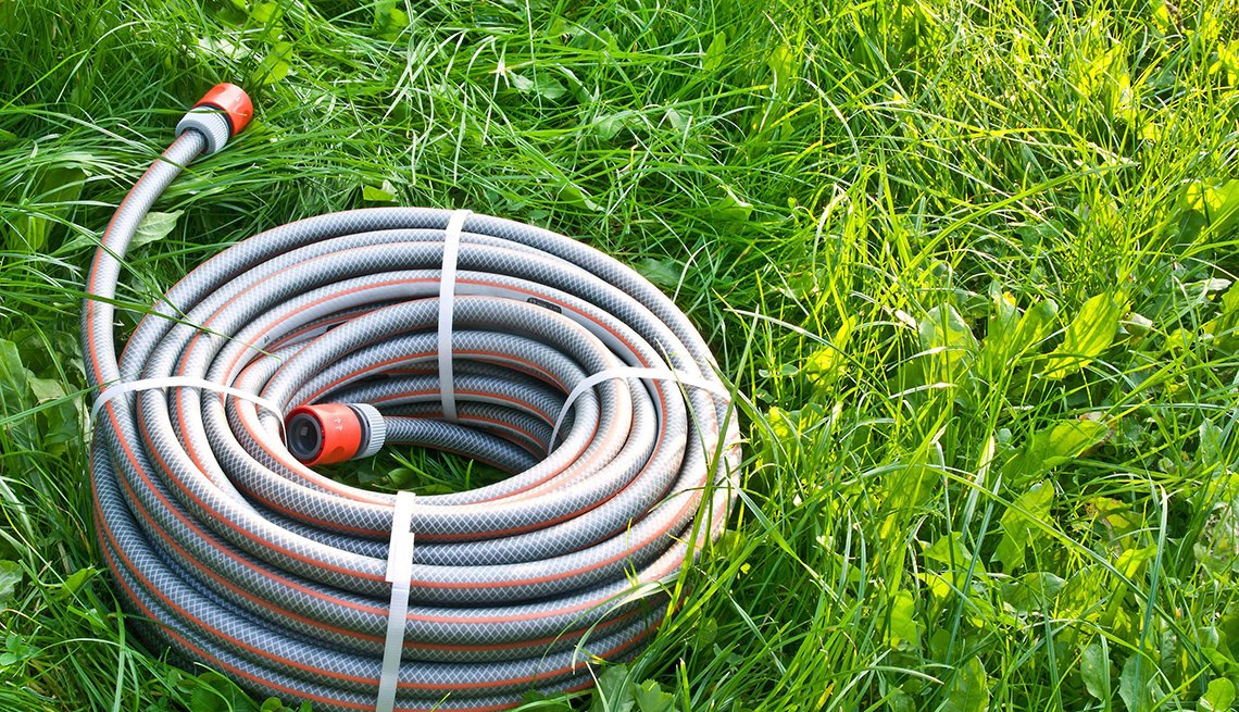 Gardening hose in grass