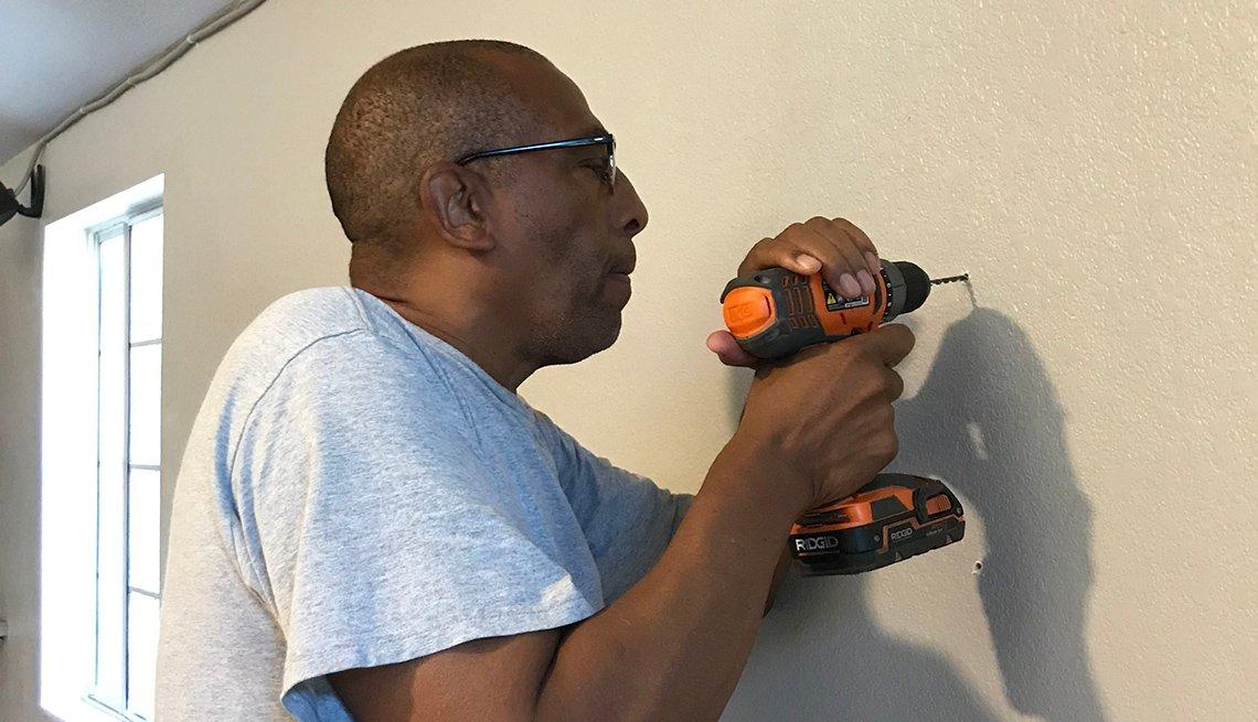 Theodis Scott with a drill