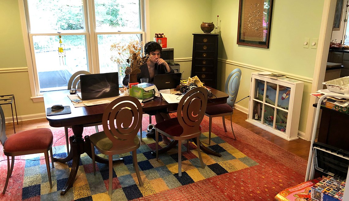 photo of a living and dining room area with a lot of clutter