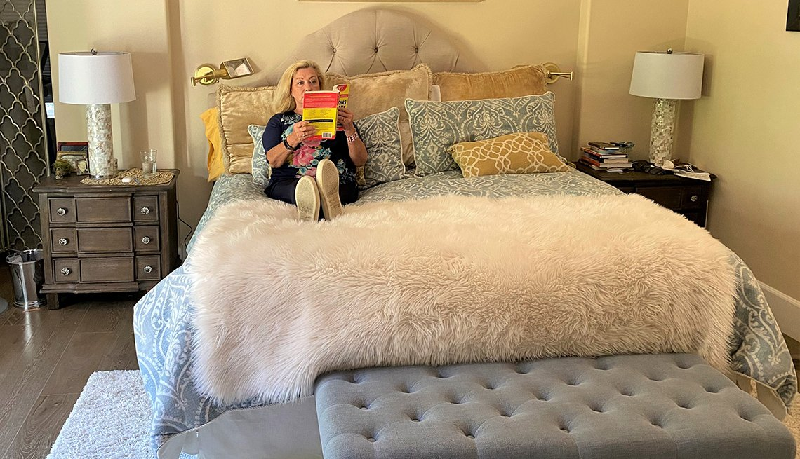 Patti Cohn of Ross, Calif., relaxes in her refreshed bed, where she has been spending more time during the pandemic