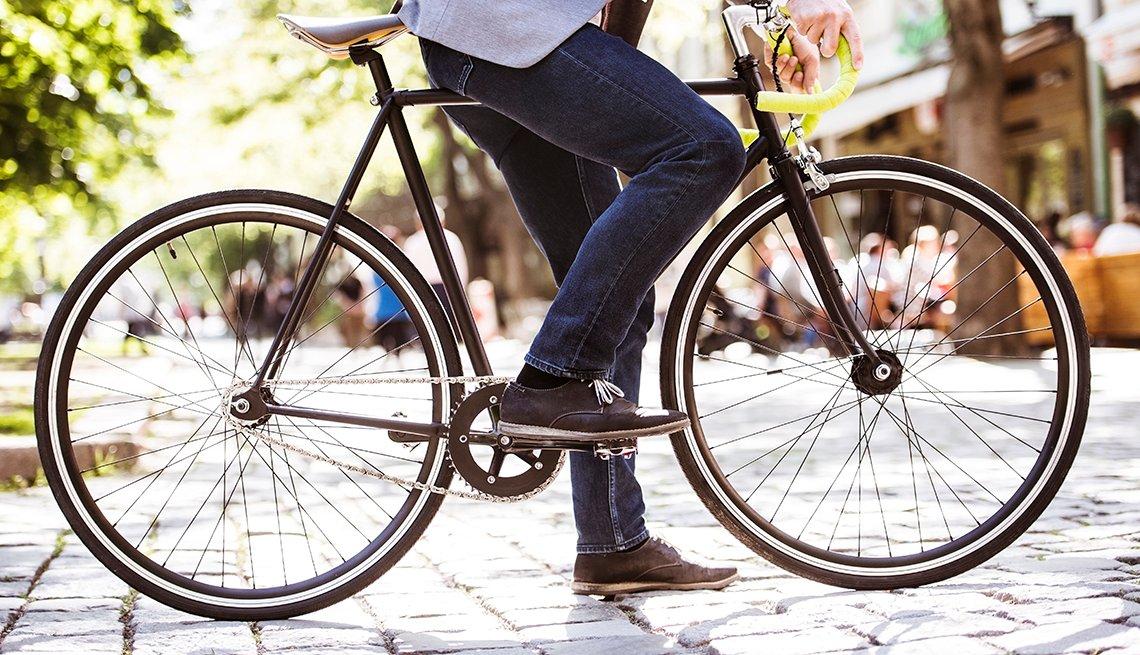 A man on a city street riding a bike