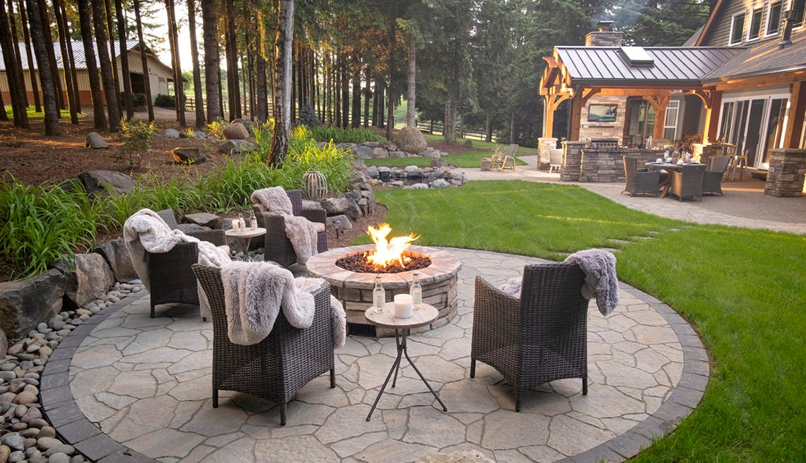 A firepit and seating with cozy comforters