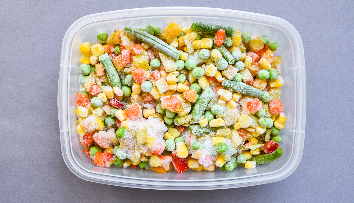 Frozen mixed vegetables in a plastic container for long-term storage.