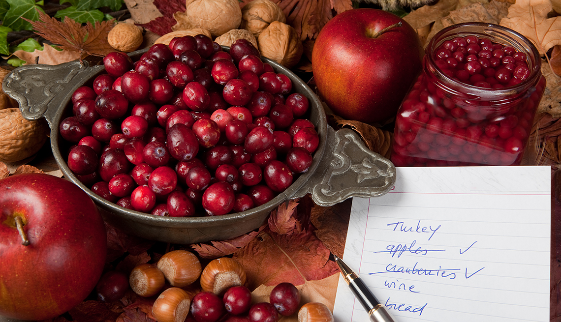 Thanksgiving shopping list with cranberries, apples and nuts