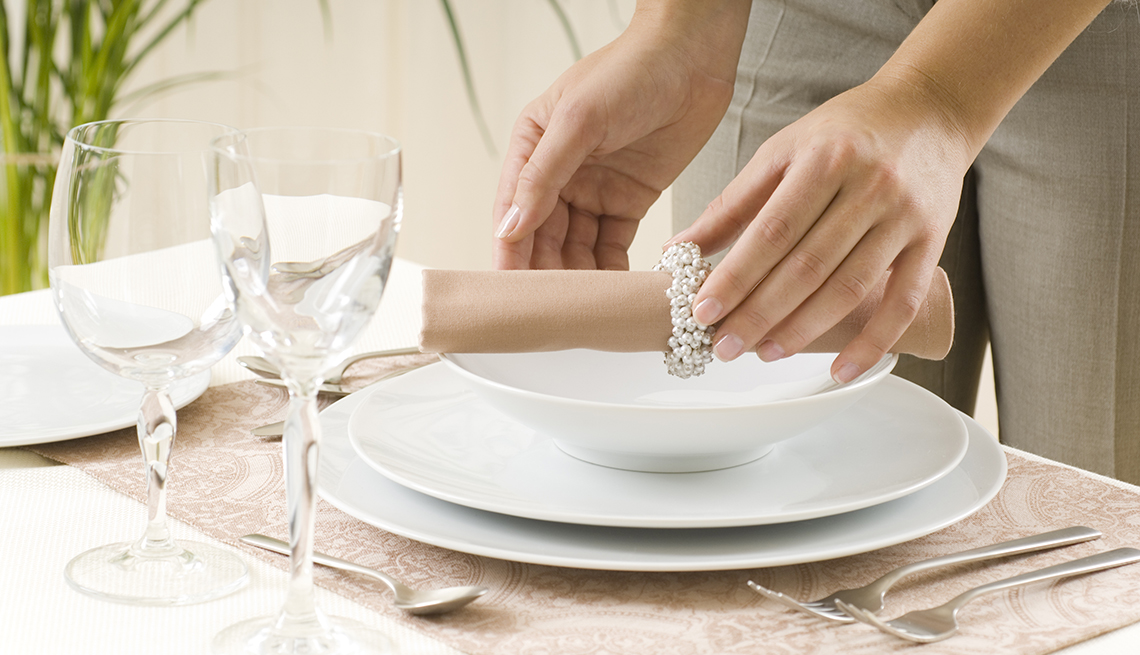 Woman setting a table