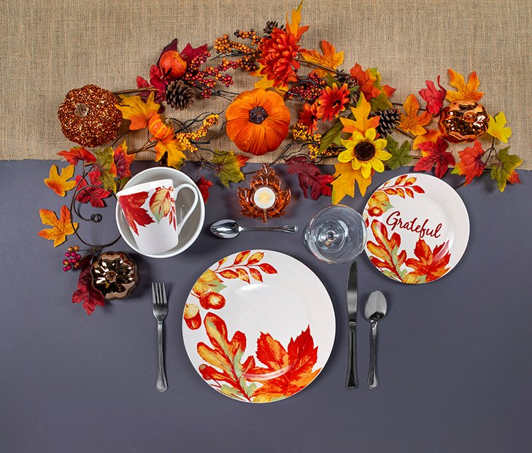 Dollar Tree stores and its website offer an assortment of Thanksgiving-themed tableware ranging from faux wood charger plates to oven mitts for $1 each.