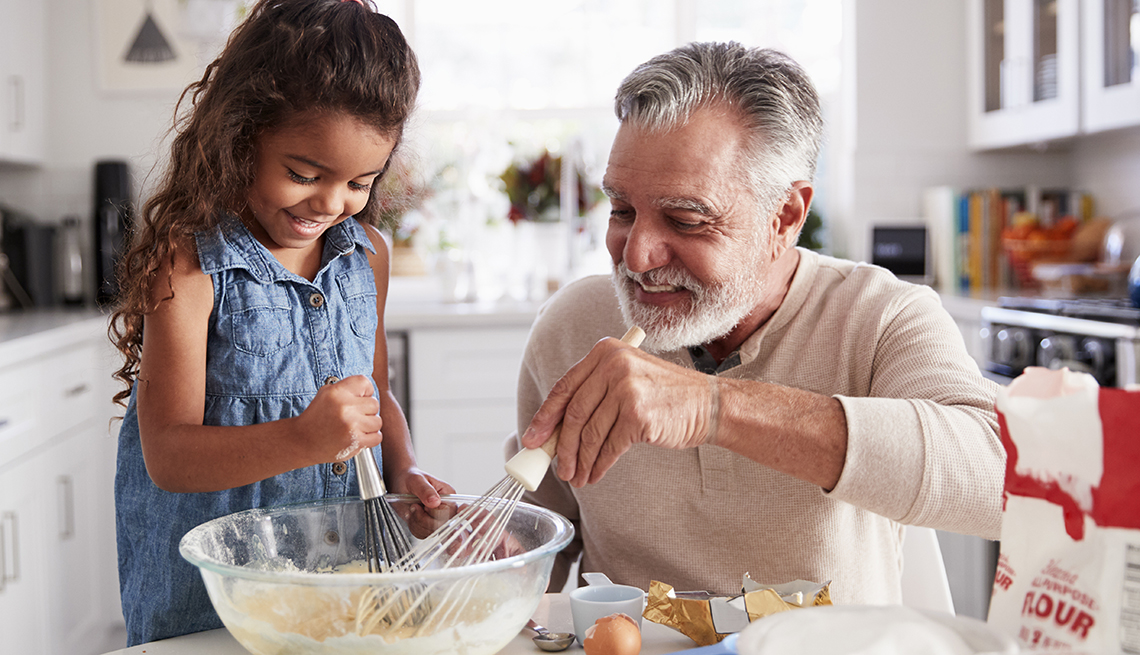 Young girl and her grandad baking