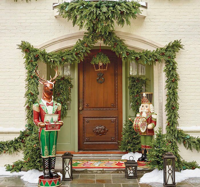 item 2 of Gallery image - Front door decorated in garland, with a dog smiling