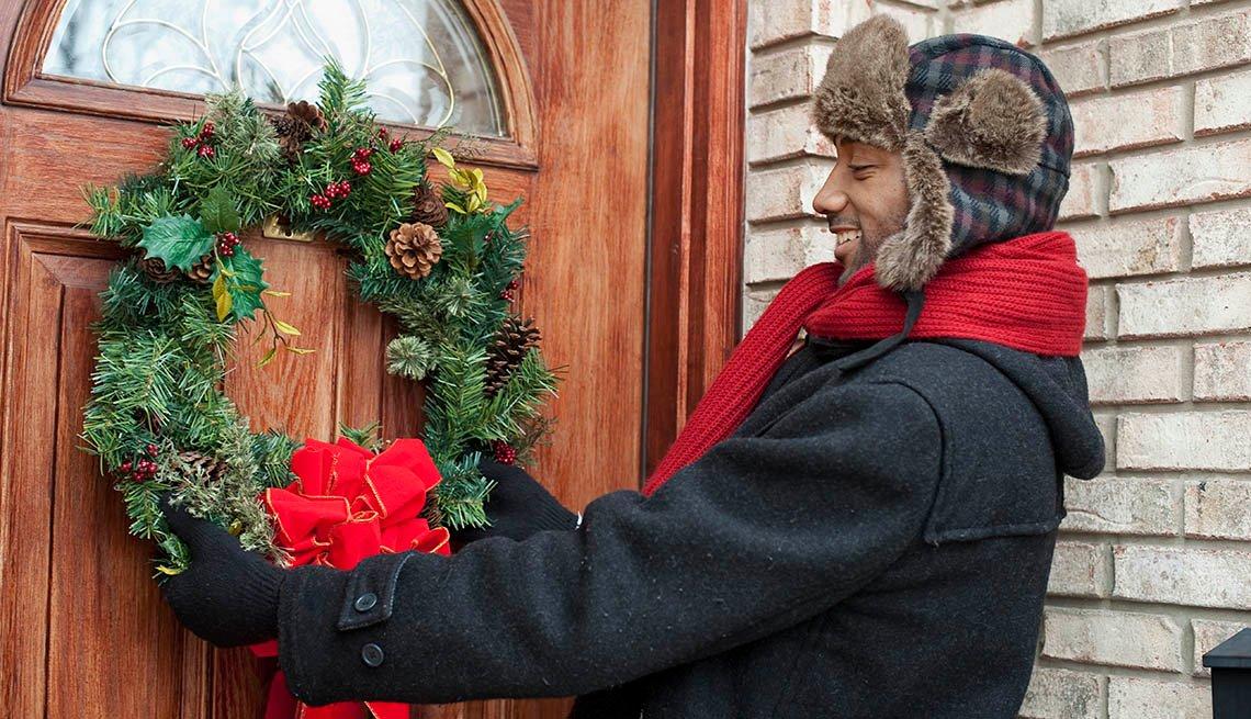 Man decorating front door