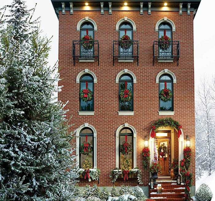 item 3 of Gallery image - Front door of a home decorated for the holidays