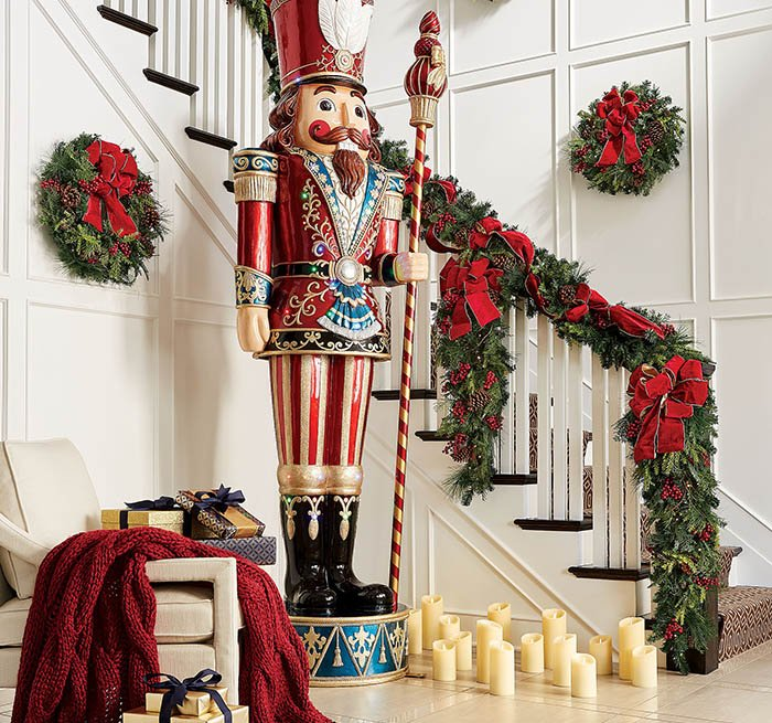 item 6 of Gallery image - Christmas decor display of a Nutcracker statue on display in a home decorated with wreaths, candles