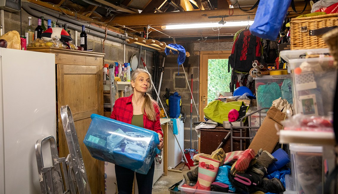 A woman organizes her garage