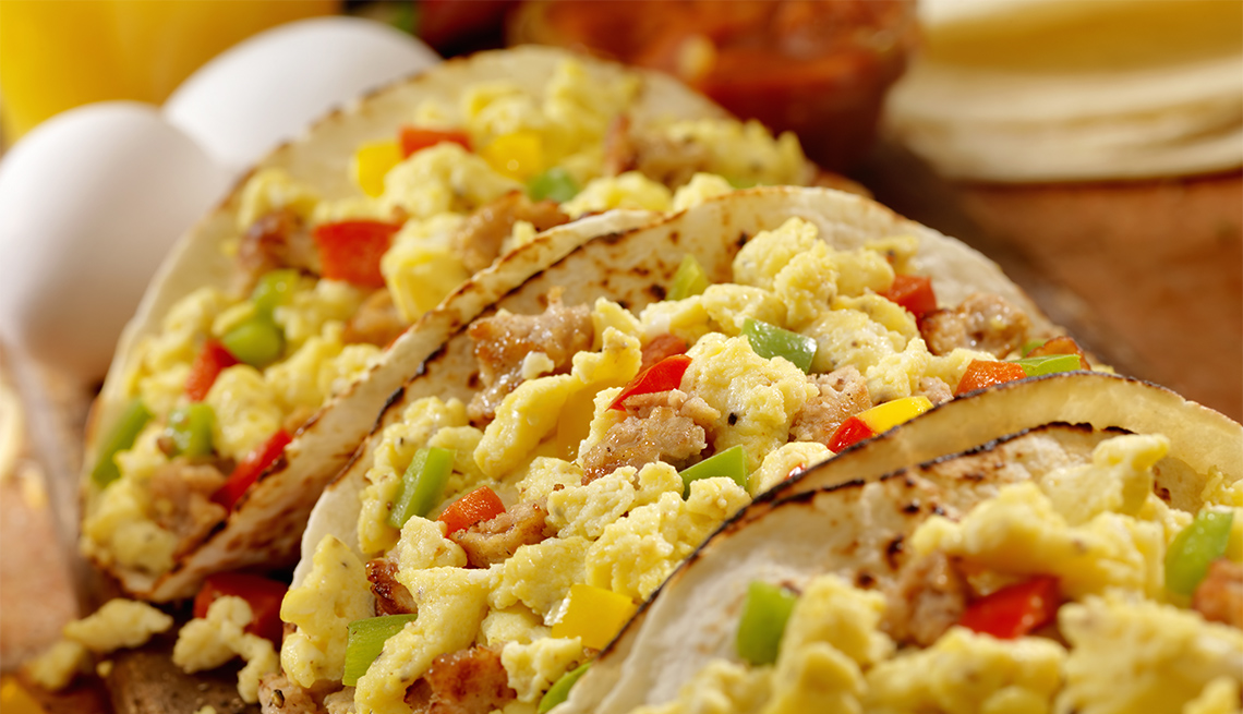 Breakfast Taco with scrambled eggs, sausage, peppers and cheddar cheese