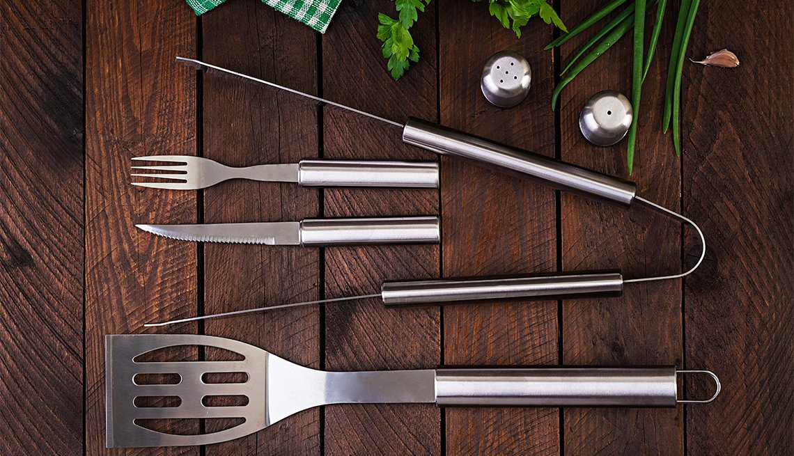 Barbecue tools on wooden table