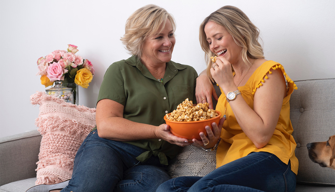two females eating caramel popcorn