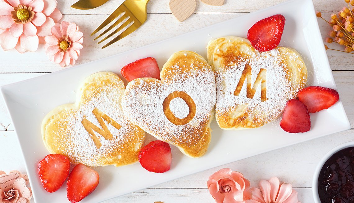 Heart shaped pancakes with MOM letters on them