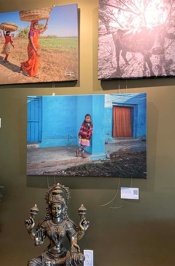 wall of photos and statue inside of the Narmada Winery