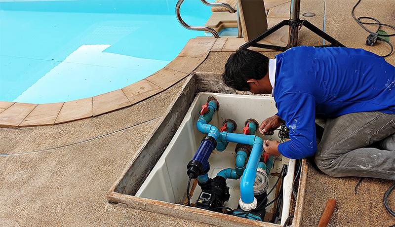 Technician fixing swimming pool water pump
