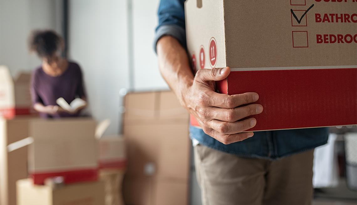 Closeup of man hand holding cardboard