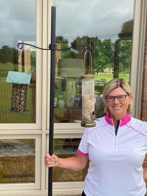Rebecca Delayahe displays her bird feeders