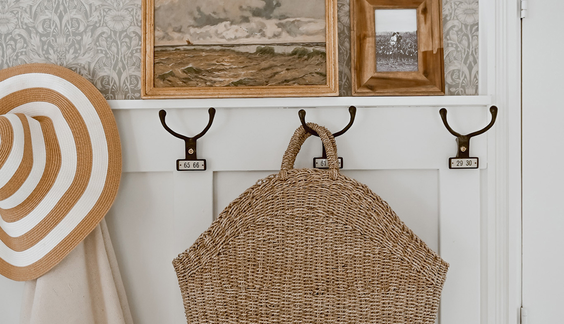 a set of hanging hooks for bags hats and coats