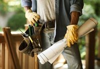 webinar on how to hire a contractor, man with tool belt and gloves and blueprints
