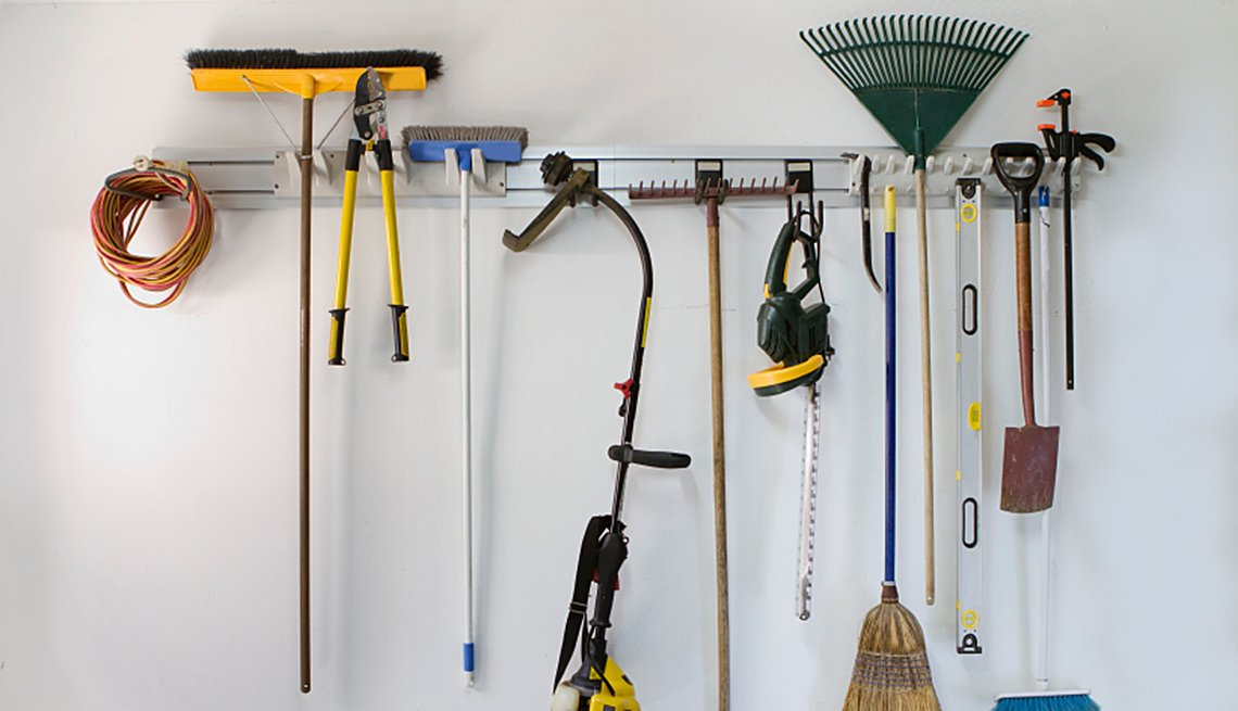 Tools Handing From Bar In Garage, AARP Home And Garden, Home Improvement, How To Organize A Garage