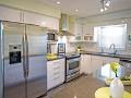 Tendencias en el hogar que tendrán mayor impacto en tu bienestar - Plano abierto de una cocina en casa