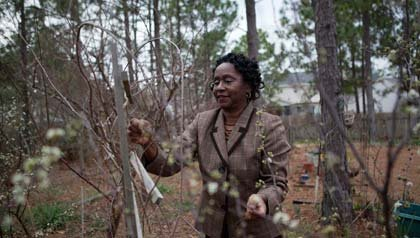 South Carolina's HELP Program has money to avoid foreclosure, woman in backyard