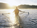 Sports and the outdoors draw active seniors to retire in Bellingham, Washington- a person rows on Lake Whatcom
