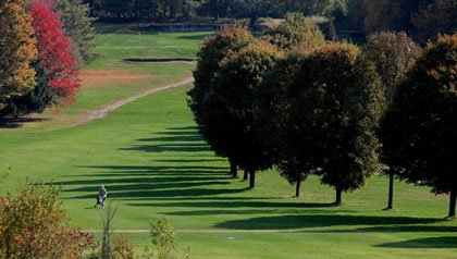 The Pioneer Valley of Massachusetts is a popular place to retire- a golfer walks through a course in Amherst, MA