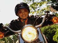 Boomer riding motorcycle - senior centers emphasize health and wellness, the arts, life-long learning.
