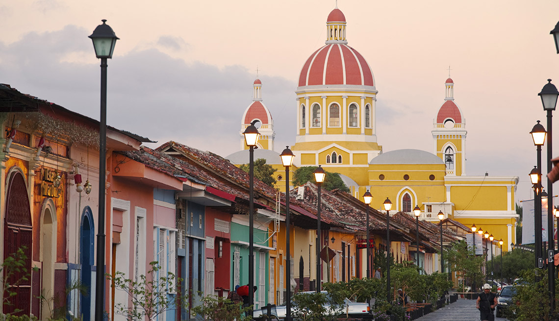 Town Street With Colorful Houses And Church In Background In Grenada Nicaragua, Cheap Places To Retire