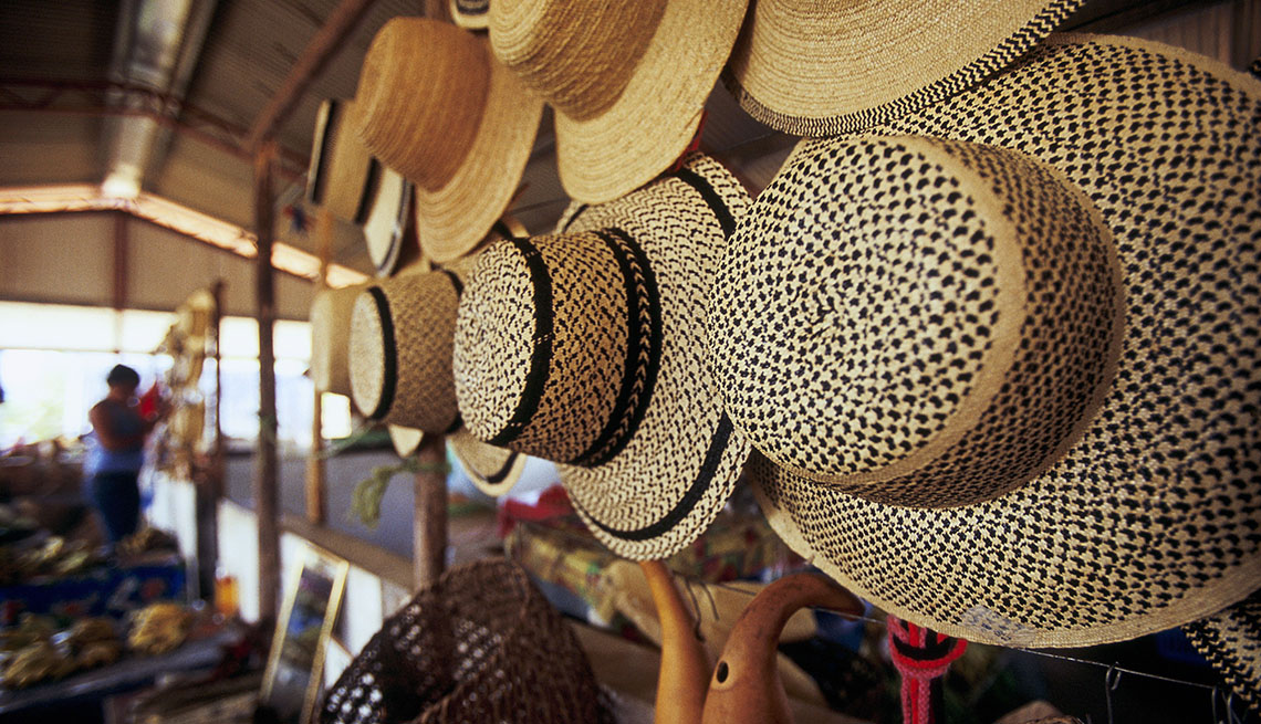 A Row Of Hats Hanging For Sale In Santa Fe Panama, Cheap Places To Retire