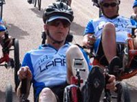 Larry Smith racing on recumbent bike.