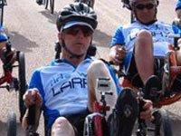 Larry Smith racing on recumbent bike.