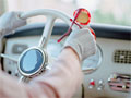 trivia quiz are you a smart driver woman's glved hands on vintage car steering wheel, red glasses